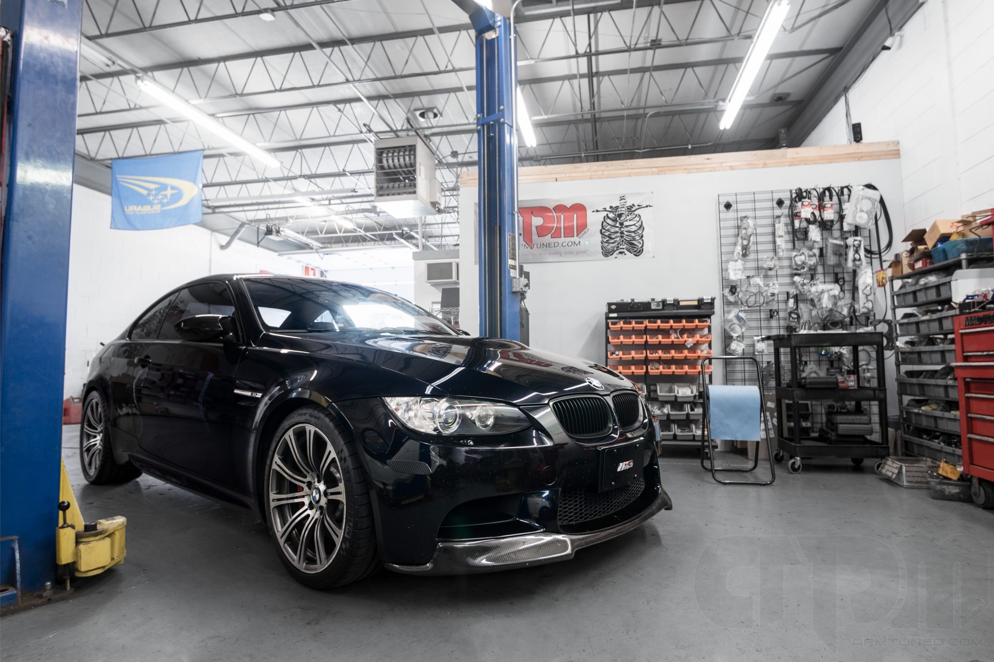 Black BMW M3 in our shop getting ready for an exhaust modification