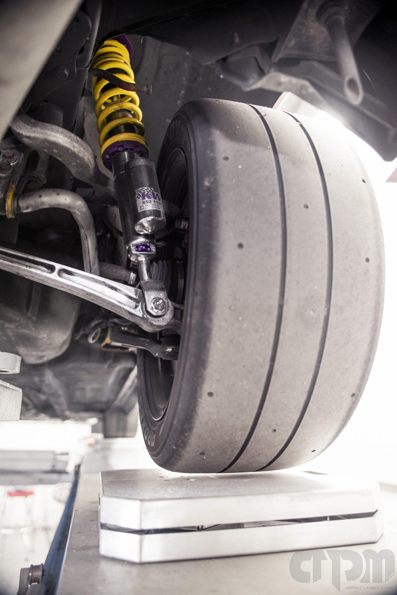 close up of our shop race car Mitsubishi Evo getting corner balanced
