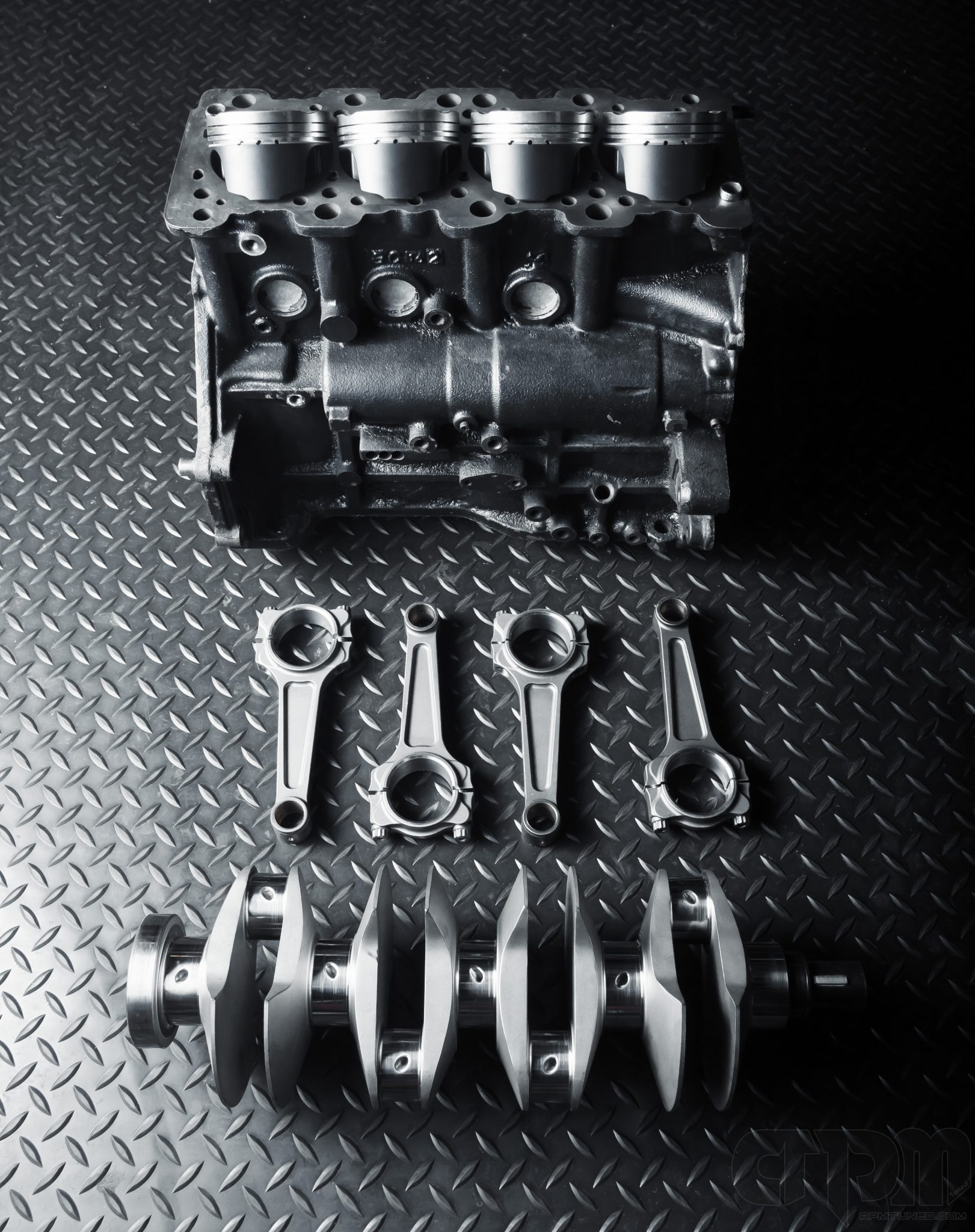 Evo shortblock with crankshaft, pistons, rods, getting ready for assembly