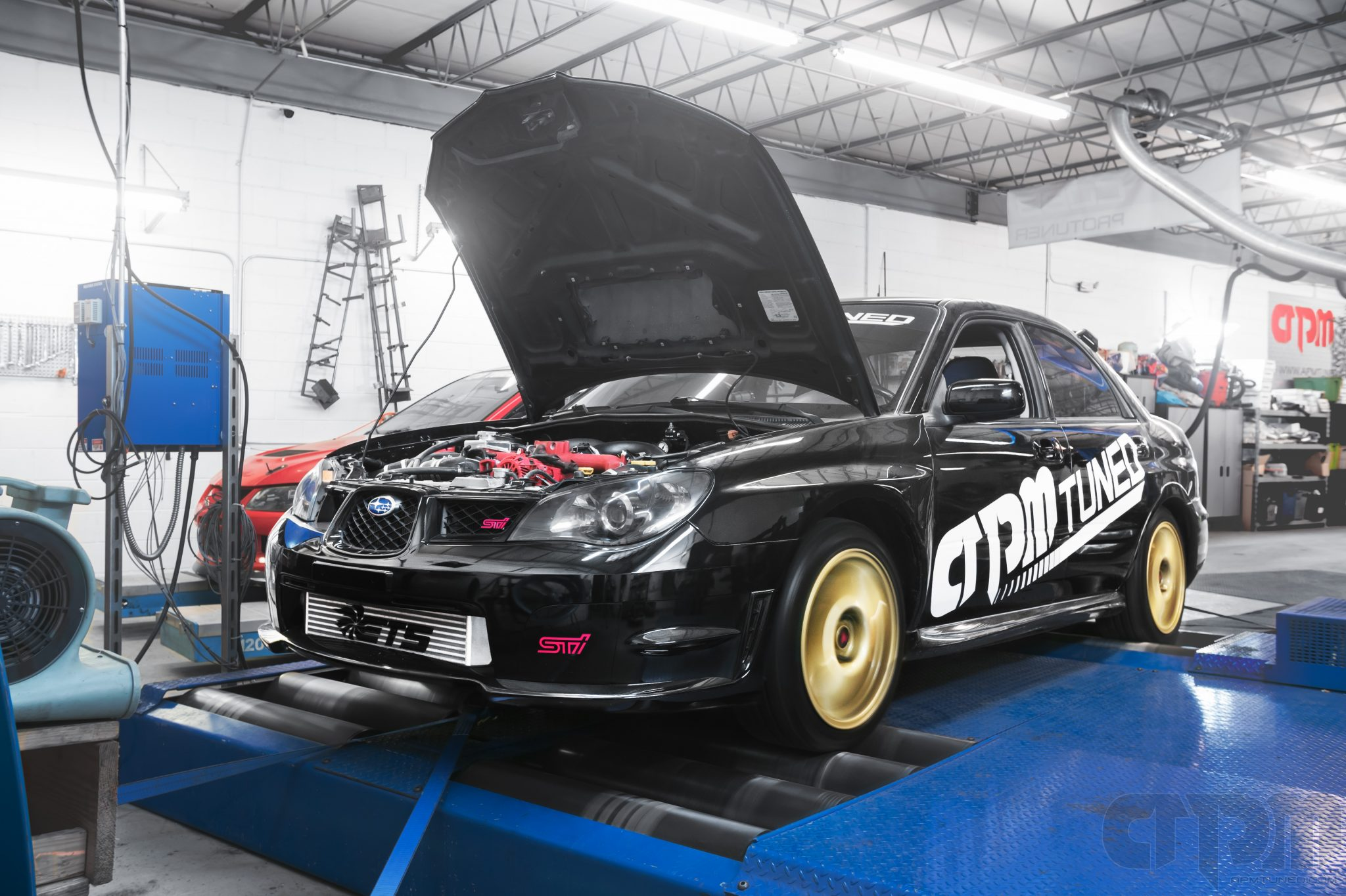 APMTuned's black Subaru STi hawkeye shop race car getting tuned on our Mustang Dynamometer AWD 4WD Dyno