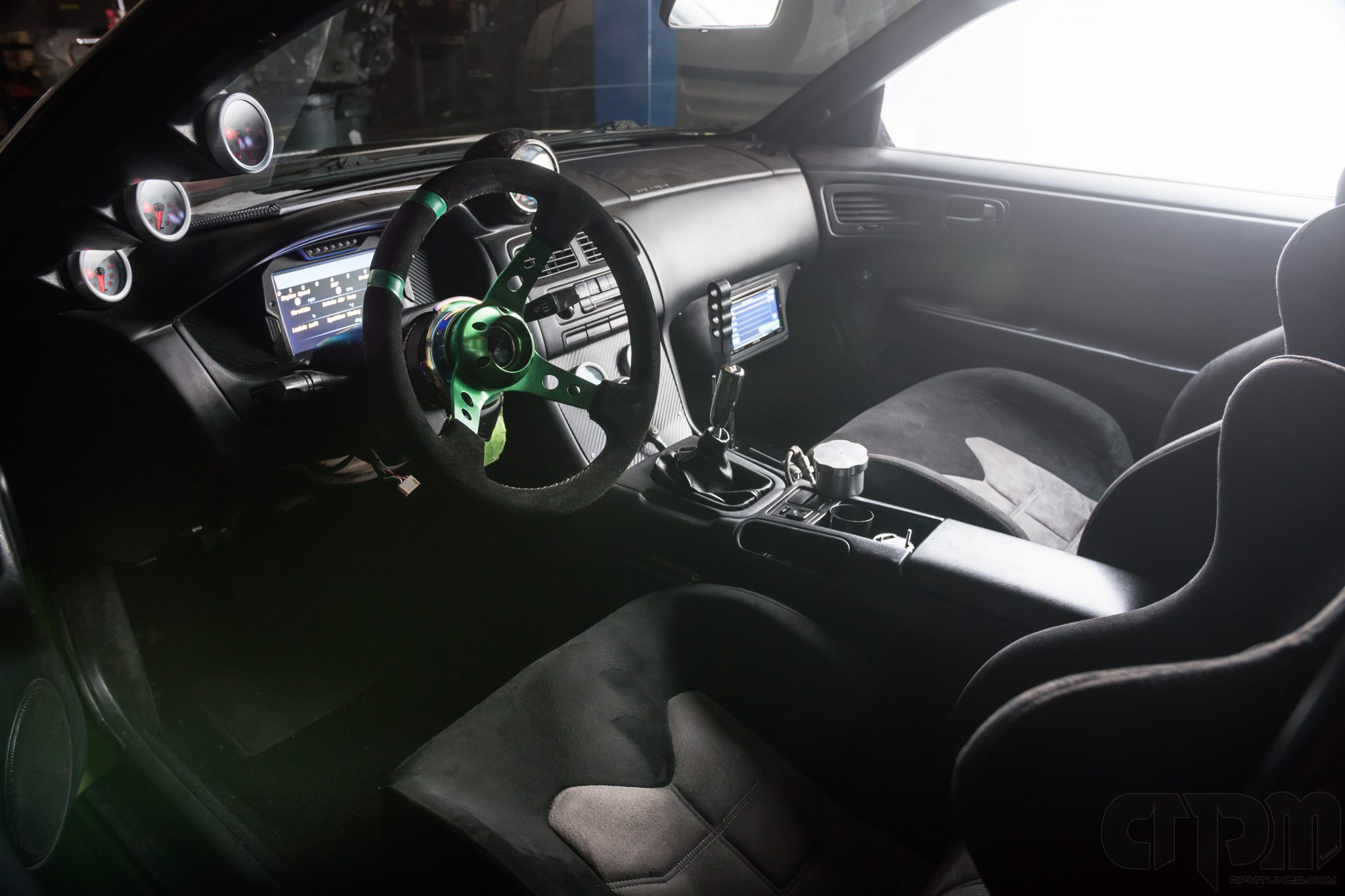 Interior of 240sx drift car with custom installed AEM display and AEM Gauges